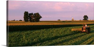 Farmer harvesting a field, Lancaster County, Pennsylvania