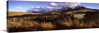 Fence with mountains in the background, Colorado,