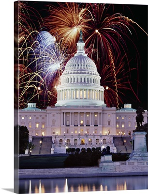 Firework display over a government building at night, Capitol Building, Washington DC
