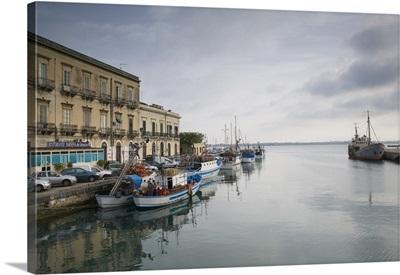 Fishing boats docked at a harbor, Ortygia, Siracusa, Sicily, Italy