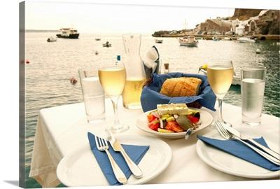 Food on a table at the seaside, Ammoudia, Santorini, Cyclades Islands, Greece