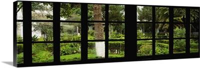 Formal garden viewed through a window, Hosteria La Cienega, Latacunga, Cotopaxi, Ecuador