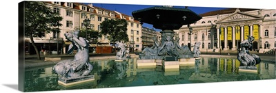 Fountain in front of an opera house, Praca Rossio, National Theatre Dona Maria II, Lisbon, Portugal