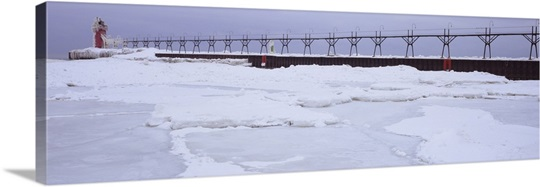 Frozen lake with a lighthouse in the background, Lake Michigan, St. Joseph, Michigan