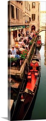 Gondolas moored outside of a cafe, Venice, Italy