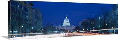 Government building lit up at dusk, Capitol Building, Pennsylvania Avenue, Washington DC