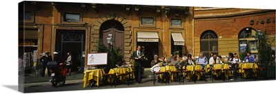 Group of people at a sidewalk cafe, Rome, Italy
