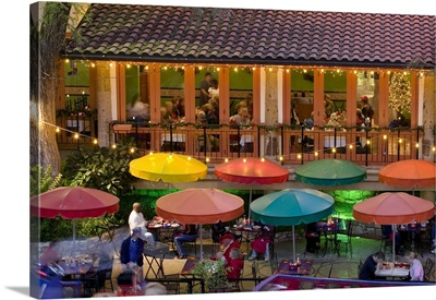 Group of people in a restaurant lit up at dusk, San Antonio, Texas