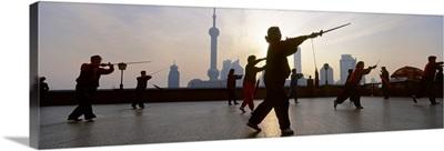 Group of people practicing Tai Chi, The Bund, Shanghai, China