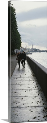 Group of people walking along a river, Neva River, St. Petersburg, Russia