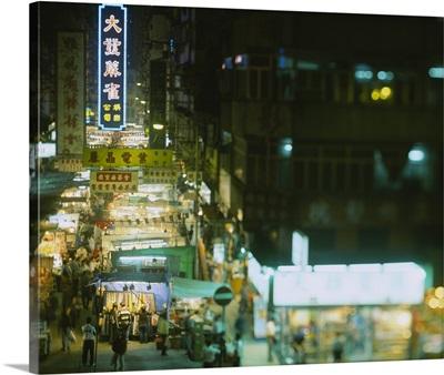 High angle view of a market lit up at night, Yau Ma Tei, Temple Street Market, Kowloon, Hong Kong, China
