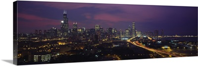 High angle view of buildings lit up at dusk, Chicago, Illinois