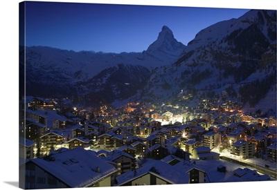 High angle view of buildings lit up at dusk, Matterhorn, Zermatt, Switzerland