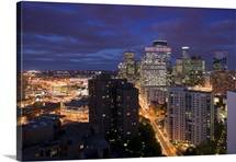 High angle view of buildings lit up at night, Minneapolis, Minnesota