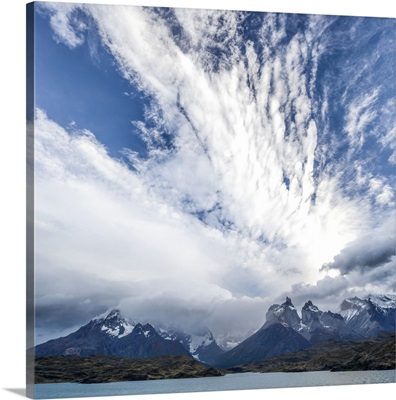 High storm clouds fill the sky above the mountains, Lake Pehoe, Chile