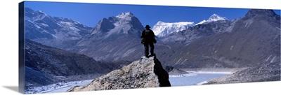 Hiker standing on a rock, Gokyo Valley, Khumbu, Nepal