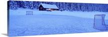Hockey net on a snowcapped landscape, Lake Louise, Alberta, Canada