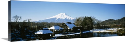 Houses in front of a mountain, Mt Fuji, Honshu, Japan