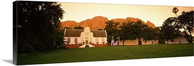 Lawn in front of a Cape Dutch Style house with a mountain and Simonsberg in the background, Stellenbosch, Cape Winelands, Western Cape Province, South Africa