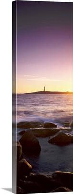 Lighthouse on an island at sunset, Cape Leeuwin, Western Australia, Australia
