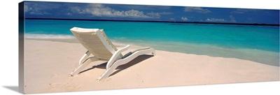 Lounge chair on the beach, Thulhagiri Island Resort, North Male Atoll, Maldives
