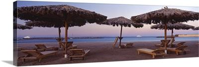 Lounge chairs with sunshades on the beach, Hilton Resort, Hurghada, Egypt