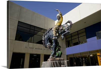 Low angle view of a statue of a cowboy on a bucking bronco in front of a museum, El Paso Museum Of Art, El Paso, Texas