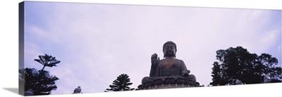 Low angle view of a statue of Buddha, Po Lin Monastery, Lantau Island, New Territories, Hong Kong, China