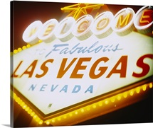 Low angle view of a welcome sign lit up at night, Las Vegas, Nevada