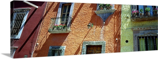 Low angle view of balconies in houses san miguel de for Low balcony wall
