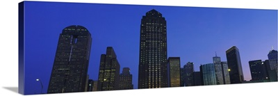 Low angle view of buildings at dusk, Dallas, Texas