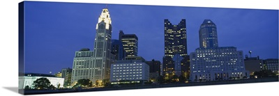 Low angle view of buildings lit up at night, Columbus, Ohio