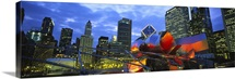 Low angle view of buildings lit up at night, Millennium Park, Chicago, Illinois