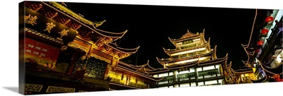 Low angle view of buildings lit up at night, Old Town, Shanghai, China