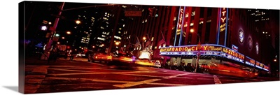 Low angle view of buildings lit up at night, Radio City Music Hall, Rockefeller Center, Manhattan, New York City, New York State