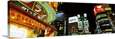 Low angle view of buildings lit up at night Shinjuku Ward Tokyo Prefecture Kanto Region Japan