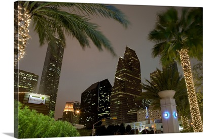 Low angle view of buildings lit up at night, Wortham Theater Center area, Houston, Texas