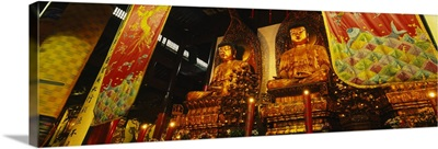 Low angle view of golden Buddha statues, Heavenly King Hall, Jade Buddha Temple, Shanghai, China