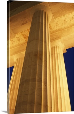 Low-angle view of Lincoln Memorial columns illuminated at night, Washington, District of Columbia