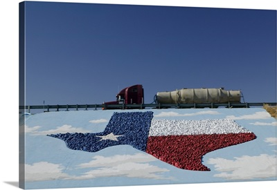 Low angle view of truck and map of Texas on the slope beside a highway, Pecos, Texas