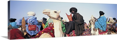 Low angle view of tuaregs riding on camels, Mali