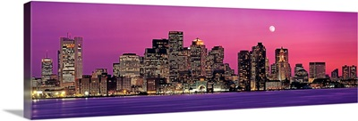 Massachusetts, Boston, View of an urban skyline by the shore at night