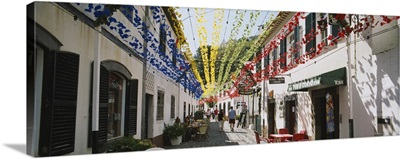 Multi-colored streamers hanging over a street, Sao Vicente, Madeira, Portugal