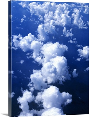 Multiple white clouds, blue sky.