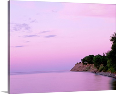 New York, Sodus Bay, Chimney Bluffs State Park, Lake Ontario, Sunset over a lake