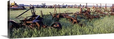 Old farm equipment in a field, Kansas