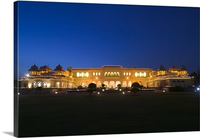 Palace lit up at dusk, Rambagh Palace, Jaipur, Rajasthan, India