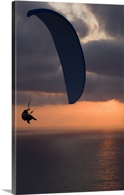 Paraglider flying in the sky over an ocean, Pacific Ocean, San Diego, California
