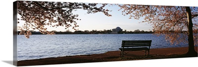 Park bench with a memorial in the background Jefferson Memorial Tidal Basin Potomac River Washington DC