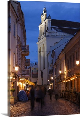People on the street at dusk, Didzioji Street, Vilnius, Lithuania